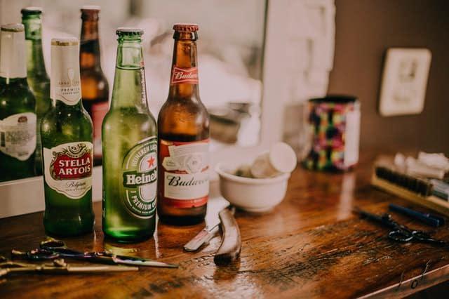 3 bottles of beer: Stella Artois, Heineken, and Budweiser.